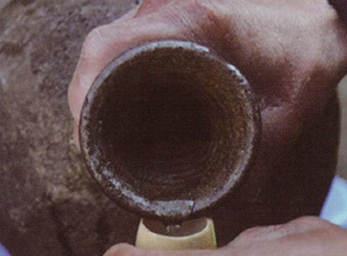 为什么用陶罐储存白酒比较好